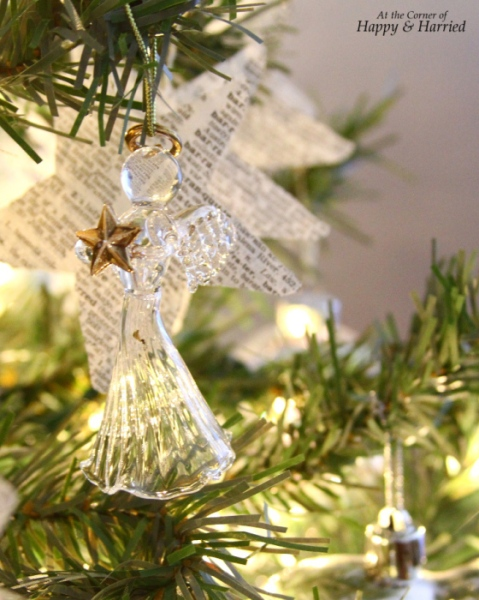 angel-book-page-star-garland-on-christmas-tree