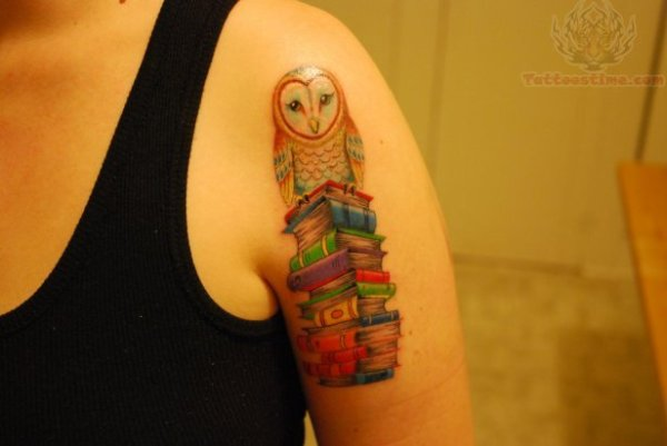 owl-sitting-on-stack-of-books-tattoo-on-bicep