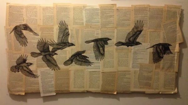 bird-pencil-drawing-on-book-pages