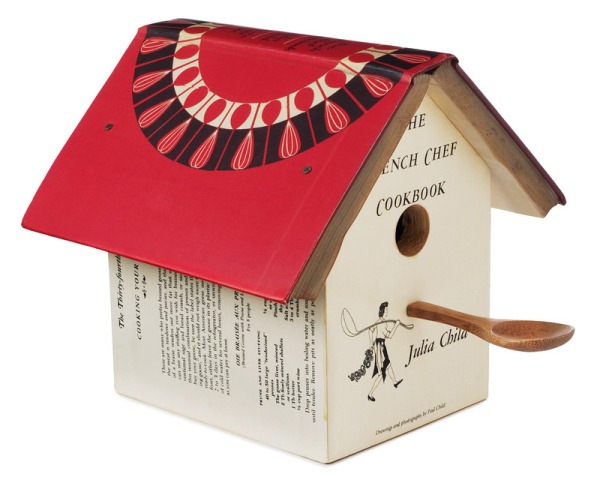 Whether you love birds, French food, Julia Child or all three, this charming birdhouse is sure to have your mouth watering. Handmade from a vintage French Chef Cookbook by Julia Child, this ornamental birdhouse is covered by the title page, two recipe pages, and a picture of Julia and features the rest of the book as a roof. The finishing touch? A perch made out of a mini wooden mixing spoon. Handmade by Dave Vissat in Pennsylvania. For decorative indoor use only.