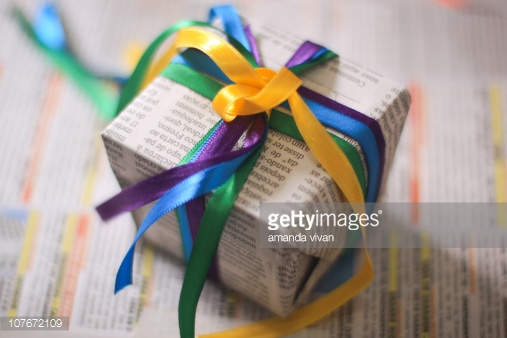 gift-wrapped-with-newspaper-picture-id107672109